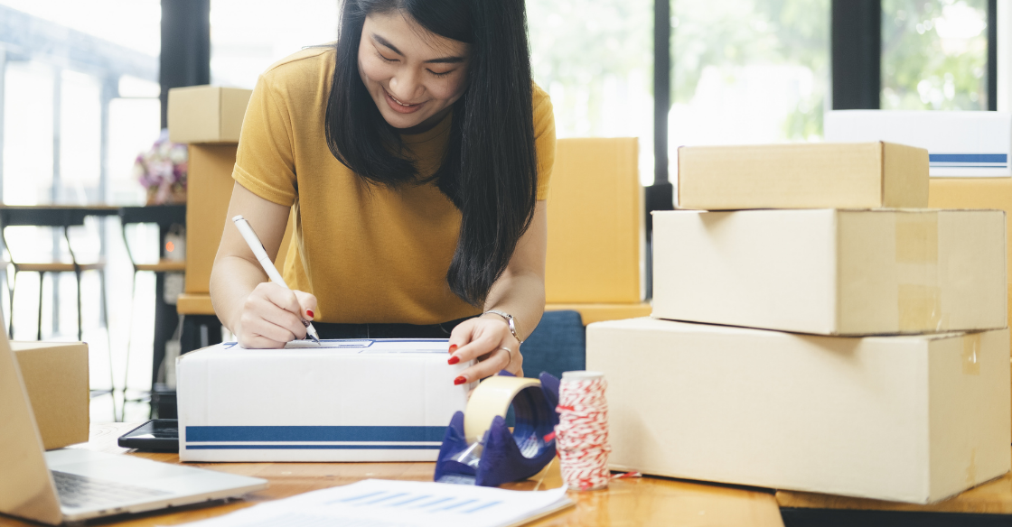 Woman packing up shipments from her eCommerce sales