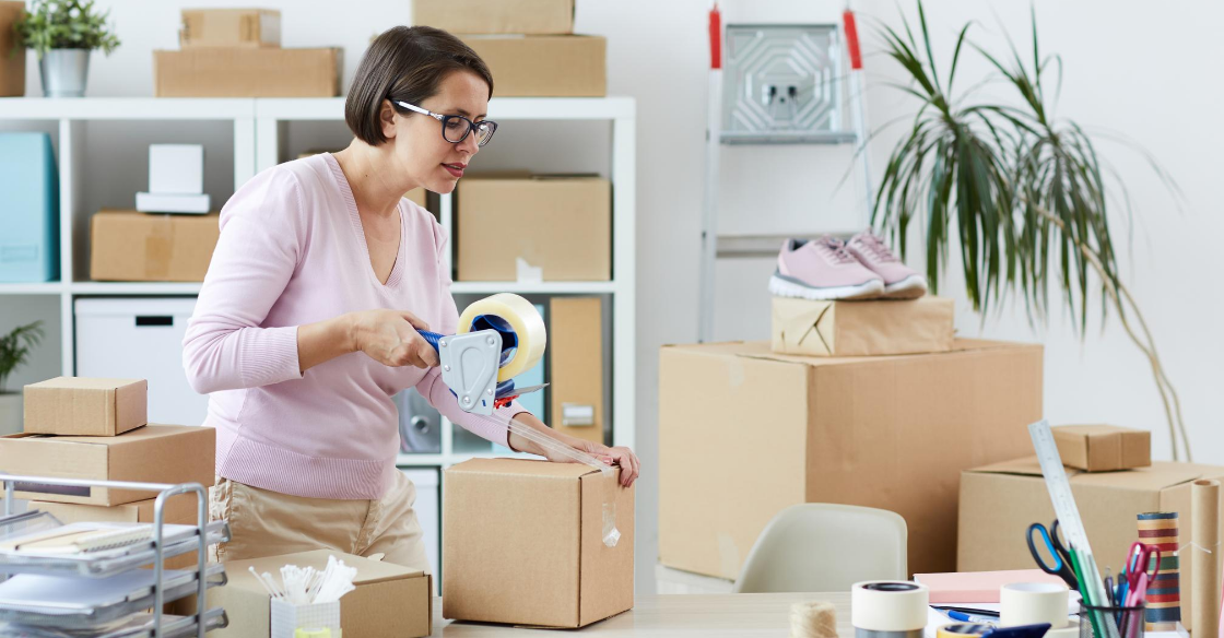 Woman packing up boxes to ship