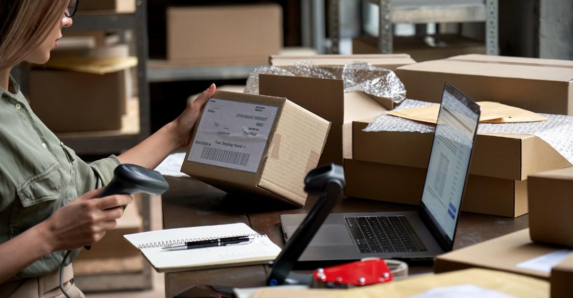 woman scanning parcel labels